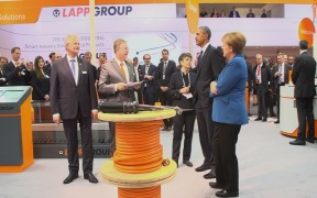 President Barack Obama and German Chancellor Angela Merkel Visit Lapp's Booth at Hanover Trade Fair